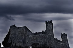 Spooky castle. Old castle with dark ominous clouds stock images