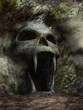 Spooky cave entrance. In the shape of a skull Stock Images
