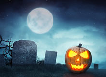 Spooky cemetery with glow halloween pumpkin Royalty Free Stock Photography