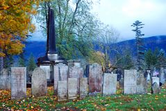 A spooky cemetery in fog. A spooky cemetery stands in a mountain fog during the Halloween season in Vermont royalty free stock photography