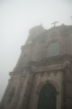 Spooky church. A church, covered in the fog which makes it look mysterious and spooky Stock Photo