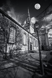 Spooky church with moon. Gothic church in shadowy black and white with moon above - composite Stock Image