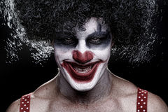 Spooky Clown Portrait on Black Background Royalty Free Stock Photo