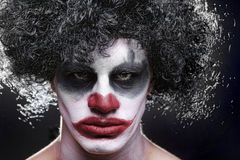 Spooky Clown Portrait on Black Background Royalty Free Stock Images