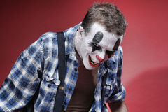 Spooky Clown Portrait on Red Background Stock Photography