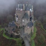 Spooky Medieval Burg Eltz Castle. Spooky, dark, magical, fairy tale, medieval Burg Eltz castle near Moseltal, Rheinland-Pfalz Germany in the morning surrounded royalty free stock image