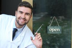 Spooky dentist holding classic anesthesia needle