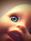Spooky Doll. Closed frame shot of child's toy doll head with faded/vintage treatment royalty free stock photography