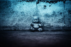 Spooky doll in haunted house. Scary background for book cover Royalty Free Stock Image