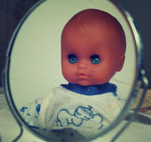 Spooky doll in the mirror 3. Stock Photo