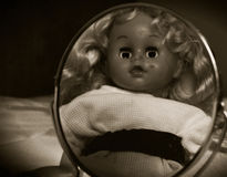 Spooky doll in the mirror 2. Royalty Free Stock Photos