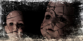 Spooky doll photograph. A spooky and disturbing image of two dolls on a grunge and old photo effect Stock Image