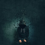 Spooky evil criminal person with hooded jacket dissolving Royalty Free Stock Photo