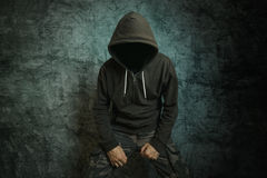 Spooky evil criminal person with hooded jacket royalty free stock photography