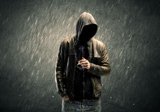 Spooky faceless guy standing in hoodie Stock Images