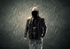 Spooky faceless guy standing in hoodie Royalty Free Stock Photography