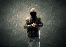 Spooky faceless guy standing in hoodie Royalty Free Stock Photo