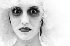 Spooky female clown. In heavy stage make-up Stock Photography