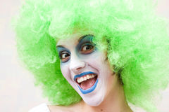 Spooky female clown. In heavy stage make-up Royalty Free Stock Images