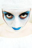 Spooky female clown. In heavy stage make-up Stock Images