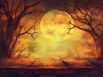 Spooky forest with full moon and wooden table Royalty Free Stock Image