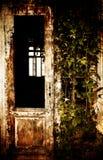 Spooky front door. Abandoned spooky front door; vintage textured old house stock photography