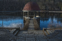 Spooky Gazebo. A spooky gazebo in the woods on a lake during the winter time stock photos