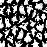 Spooky ghost Halloween holiday seamless pattern. Background. Horror night monster backdrop of flying phantom and poltergeist with scary skull for Halloween Royalty Free Stock Photo