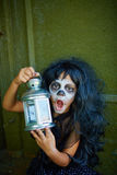 Spooky girl with lantern Stock Photos