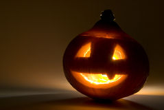 Spooky glowing halloween pumpkin Stock Photography