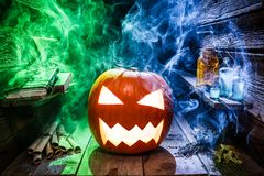 Spooky and glowing pumpkin with mist for Halloween party royalty free stock photos