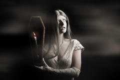 Spooky gothic girl in haunted horror house Stock Images