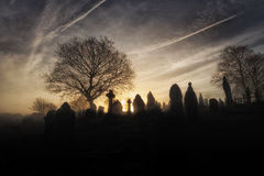 Spooky graveyard. A spooky church graveyard on a misty Winter morning royalty free stock photography