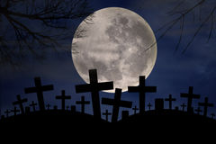 Spooky graveyard in halloween night Stock Photos