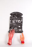 Spooky graveyard with zombie hand coming out of the ground Royalty Free Stock Images