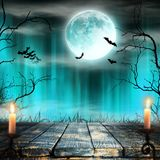 Spooky Halloween background with candles. Royalty Free Stock Images