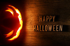Spooky Halloween background with jack o lantern Stock Photos