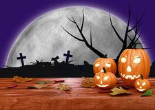 Spooky Halloween background with pumpkins in a Royalty Free Stock Image