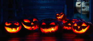 Spooky halloween background. scary pumpkin with burning eyes and Stock Photo