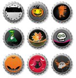 Spooky Halloween bottle caps. Royalty Free Stock Photo