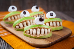 Spooky halloween edible apple monsters healthy Royalty Free Stock Photography