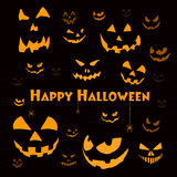 Spooky halloween faces on black Stock Image