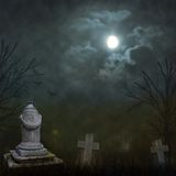 Spooky Halloween graveyard with dark clouds Stock Photo
