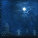 Spooky Halloween graveyard with dark clouds Stock Image
