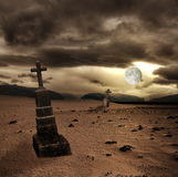 Spooky Halloween graveyard with dark clouds Royalty Free Stock Photos