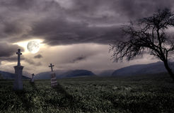 Spooky Halloween graveyard with dark clouds Stock Image