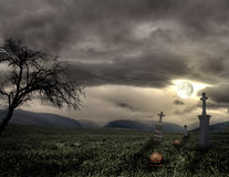 Spooky Halloween graveyard with dark clouds Royalty Free Stock Image