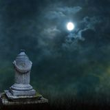 Spooky Halloween graveyard with dark clouds. And ominous moon royalty free stock photography