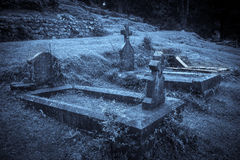 Spooky Halloween graveyard in fog Stock Photo