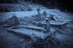 Spooky Halloween graveyard in fog Stock Photo